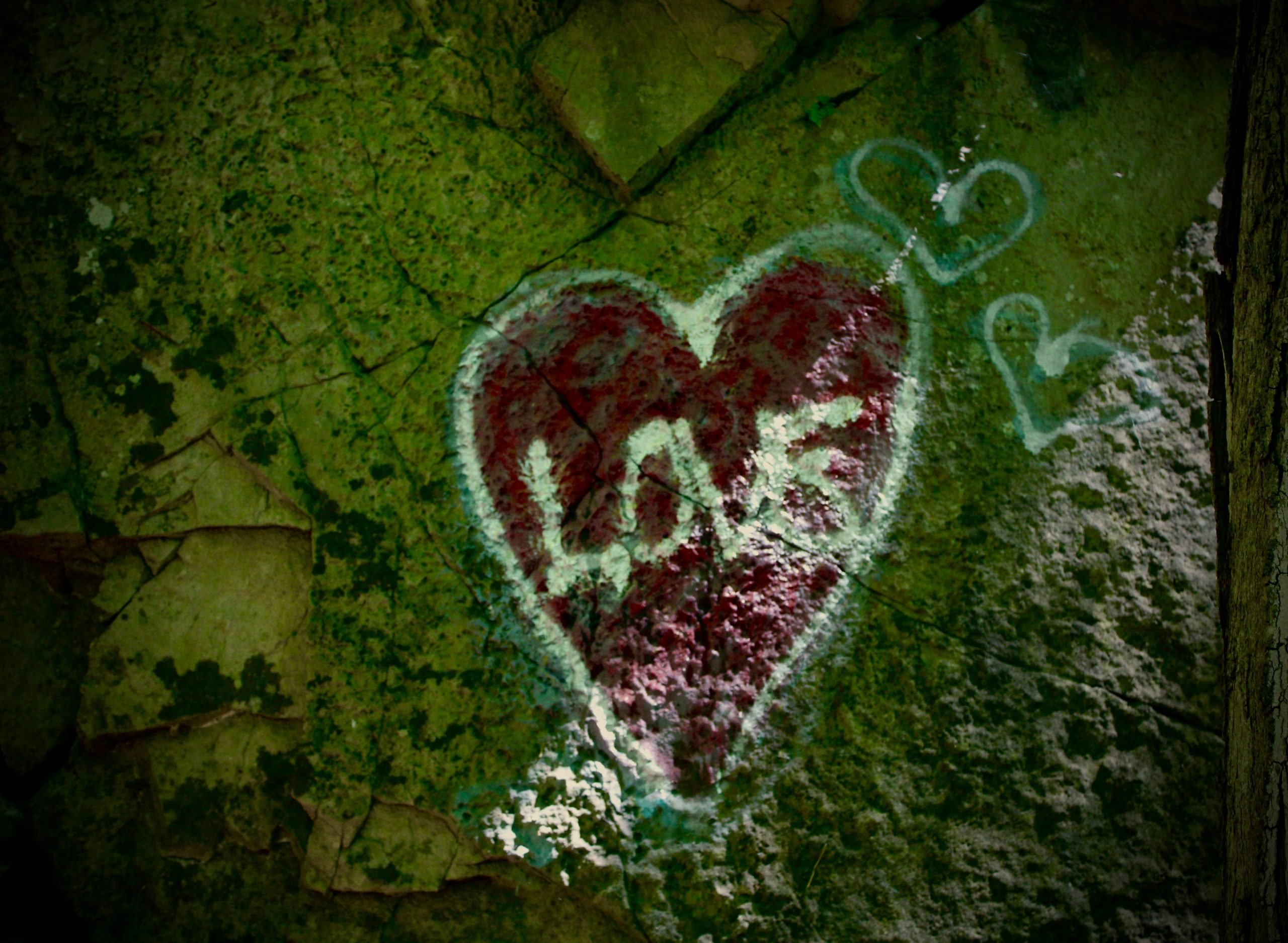 A heart spray painted on a rock