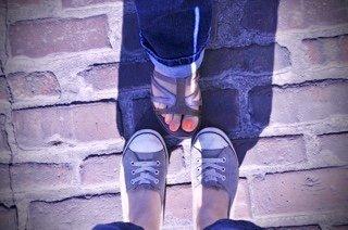 Feet on pavement