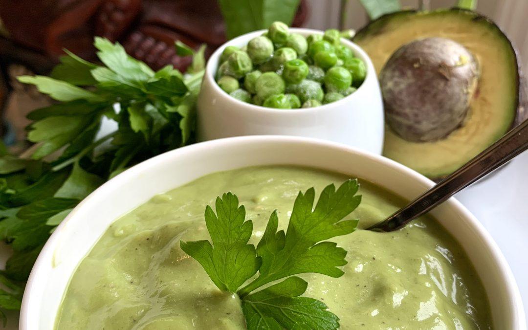 Bowl of thick green pea, avocado soup